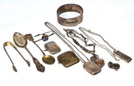 A quantity of silver to include an Albert chain, vesta cases, bangle & novelty watch key etc,