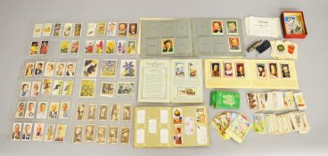 Collection of cigarette cards, an Enid Blyton card game and a whistle.