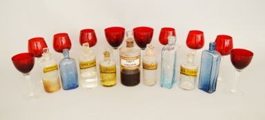 A collection of late 19th/early 20th Century apothecary and medicine bottles, some with contents.
