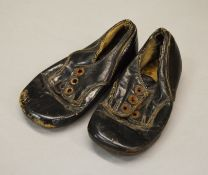 A pair of leather childrens shoes, probably late 19th/early 20th Century.