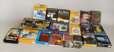 Box of assorted vintage Apple Mac games and software.