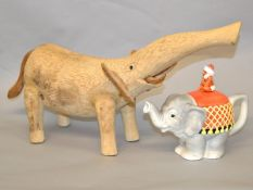 A wooden elephant of crude contemporary design, length 27cm approx.