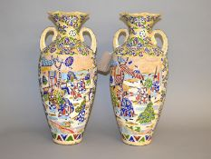 A good pair of Japanese Satsuma Moriage vases. Height 49cm approx.