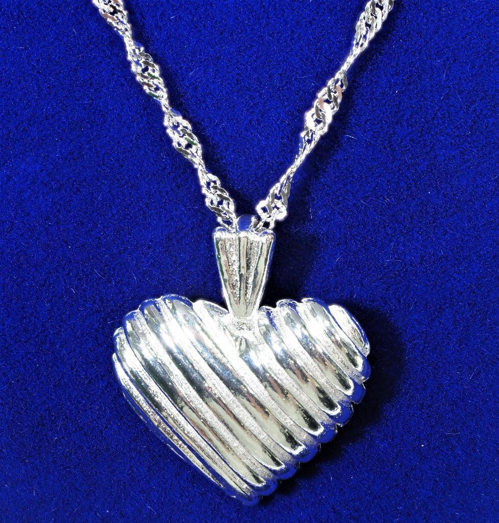 Lot 10 - Sterling Silver Heart Shaped Pendant, Retail $120