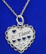 "Lot 12 - Sterling Silver Heart Shaped ""Je t'aime"" Pendant, Retail $120"