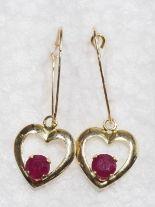 Lot 53 - 10K Gold Heart Shaped Ruby (0.70ct) Earrings. Retail $400