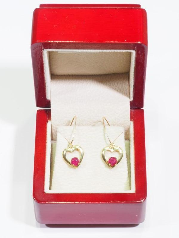 Lot 53 - 10K Gold Heart Shaped Ruby (0.70ct) Earrings. Retail $400