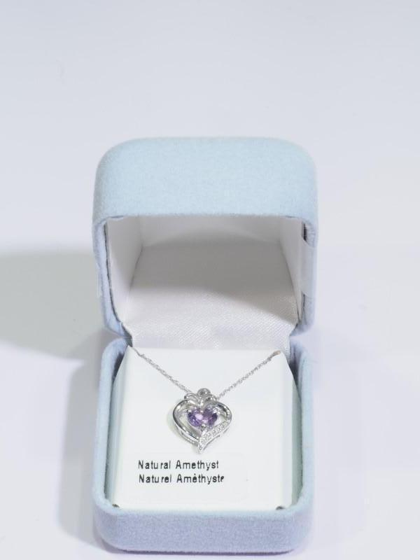 Lot 56 - Sterling Silver Amethyst Heart Shaped Necklace. Retail $100