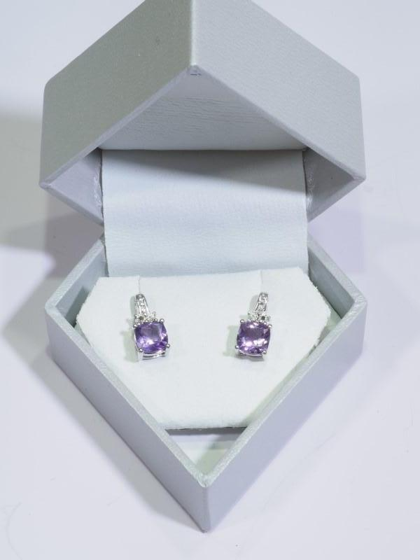 Lot 58 - Sterling Silver Amethyst (February Birthstone) and Diamond Earrings. Retail $240