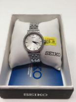 Lot 6 - Seiko Watch - Silver Band, Crystals around face, Blue Hands and White Face
