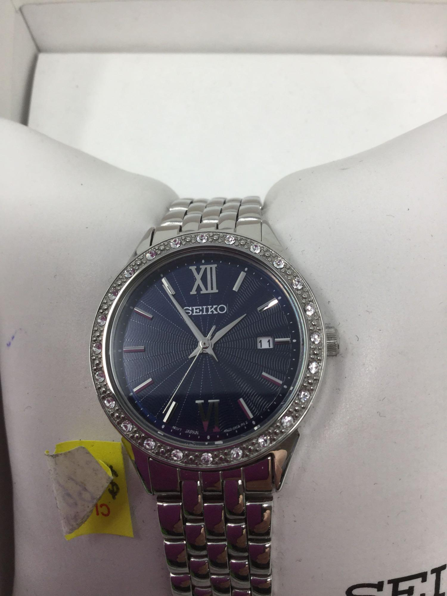 Lot 20 - Seiko Watch - Silver tone band, Crystals around Fave, and Blue Face