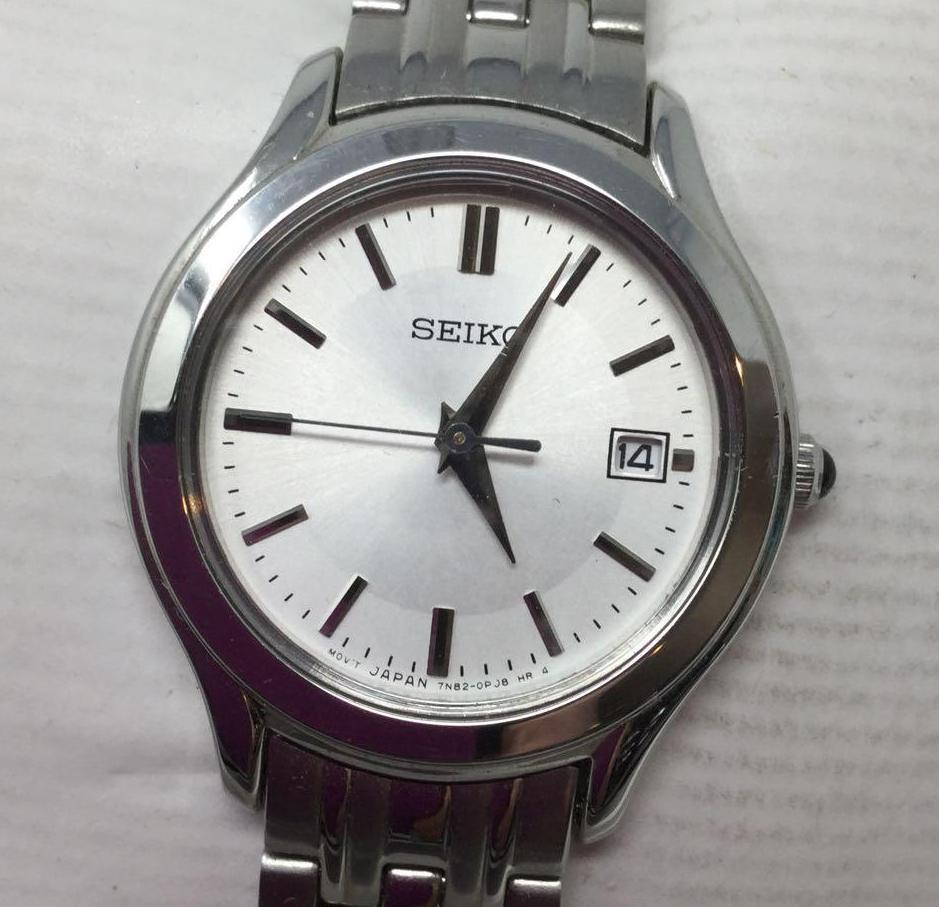 Lot 3 - Seiko Watch - Silver band and White Face