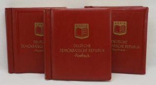 Drei Alben mit Briefmarken der DDRAbria, DDR, 1966 - 1990, Vordruckalben, postfrisch, vollständige