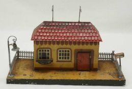 Kibri kleiner Bahnhof, 1. Hälfte 20. Jh.Blech lithografiert, mit Lampe und Ausgangsschild,