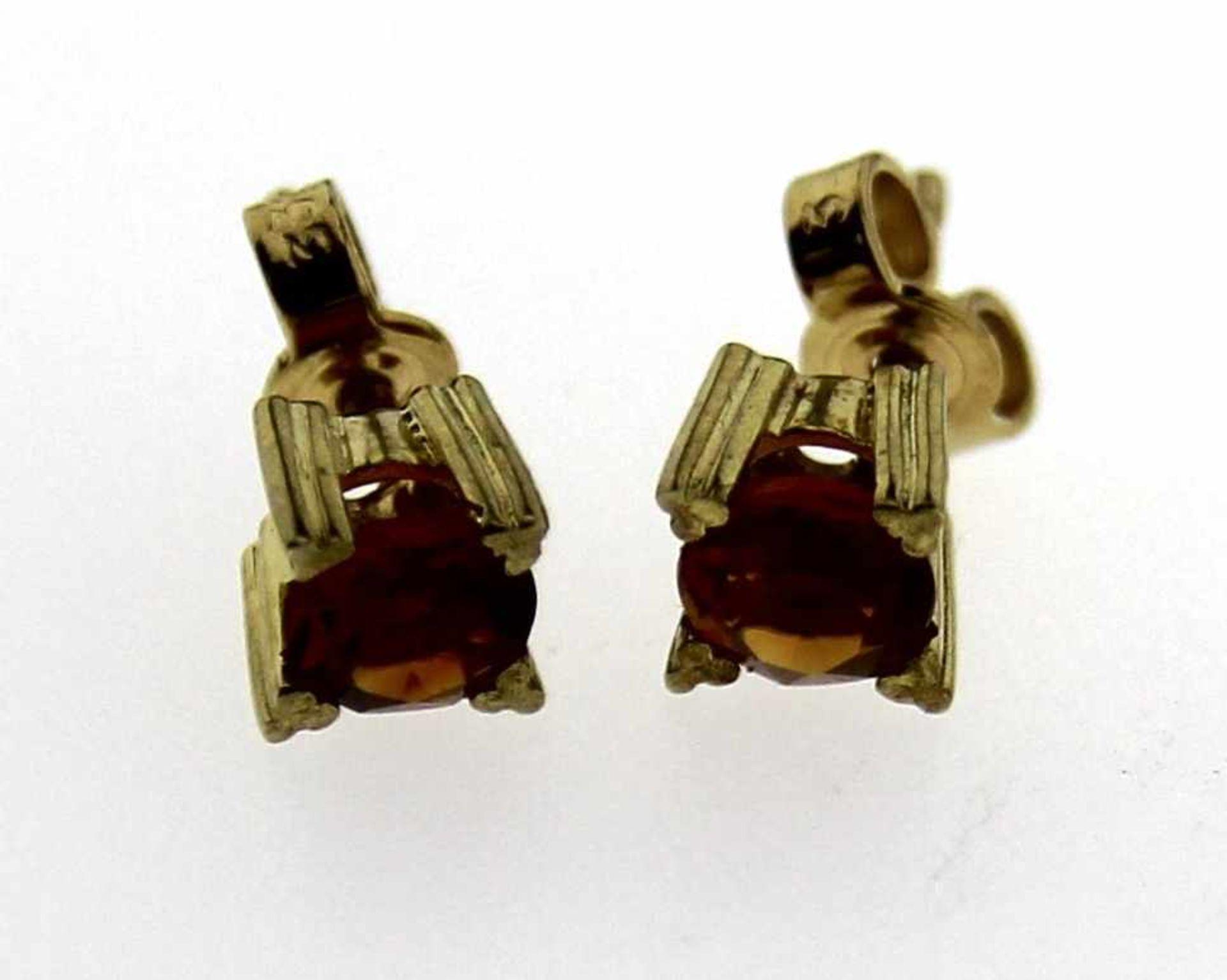 Ohrstecker 333 Gold mit Zitrin, NOS Gesamtgewicht ca. 1,3 Gramm, Zitrin in Krappenfassung ca. 5mm
