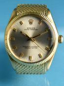 """Herrenarmbanduhr """"Oyster Perpetual"""", mit goldenem Armband und originaler Faltschließe von Rolex,"""