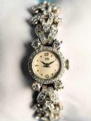 Damenarmbanduhr mit Diamanten, zusammen ca. 1,8 ct, Bezeichnet ARSA EXTRA, 70-er Jahre 750/-
