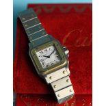 Damenarmbanduhr, Modell Montres Santos, Cartier, Paris, Kaufbeleg von 1987, Stahl/ Gelbgold. Ref.