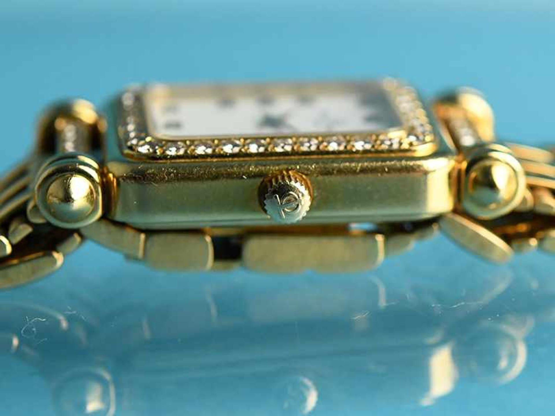 Damenarmbanduhr mit Brillanten, zusammen ca. 0,5 ct, bezeichnet Baume & Mercier, Geneve, 20. Jh. - Bild 6 aus 7