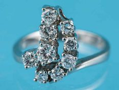Ring mit 9 Brillanten, zusammen ca. 0,8 ct, 70-er Jahre 585/- Weißgold. Gesamtgewicht ca. 4,1 g.