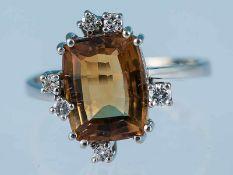 Ring mit Citrin und 6 Brillanten, zusammen ca. 0,13 ct, 70-er Jahre 585/- Weißgold. Gesmatgewicht
