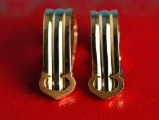 "Paar Ohrclips, Cartier, Modell ""Trinity"", 1979. 750/- Tricolor-Gold. Gesamtgewicht ca. 5,2 g."