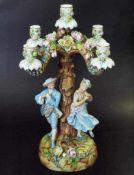 Figürlicher Kerzenleuchter. Figürlicher Kerzenleuchter. Ungemarkt, 20. Jahrhundert. Über rundem