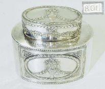 Teedose.Teedose. Deutsch, 800er Silber punziert. Zylindrischer Korpus im Empire-Stil mit
