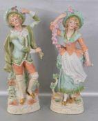 Figurenpaar Biskuitporzellan, auf Rocaillensockel stehend, tanzende Frau und Mann, teilweise bunte