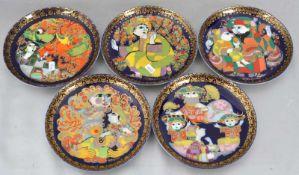 Konvolut fünf Teller gold verzierter Rand, Spiegel mit Märchenszene aus der Serie Aladin, sign.