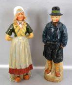 Zwei Schnapsflaschen auf Sockel stehend, holländisches Bauernpaar, bunt bemalt, abnehmbarer Kopf,