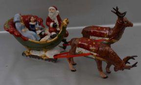 Weihnachtsschlitten mit zwei Rentierenmit zwei Kindern und Weihnachtsmann, bunt bemalt, H 18 cm, L