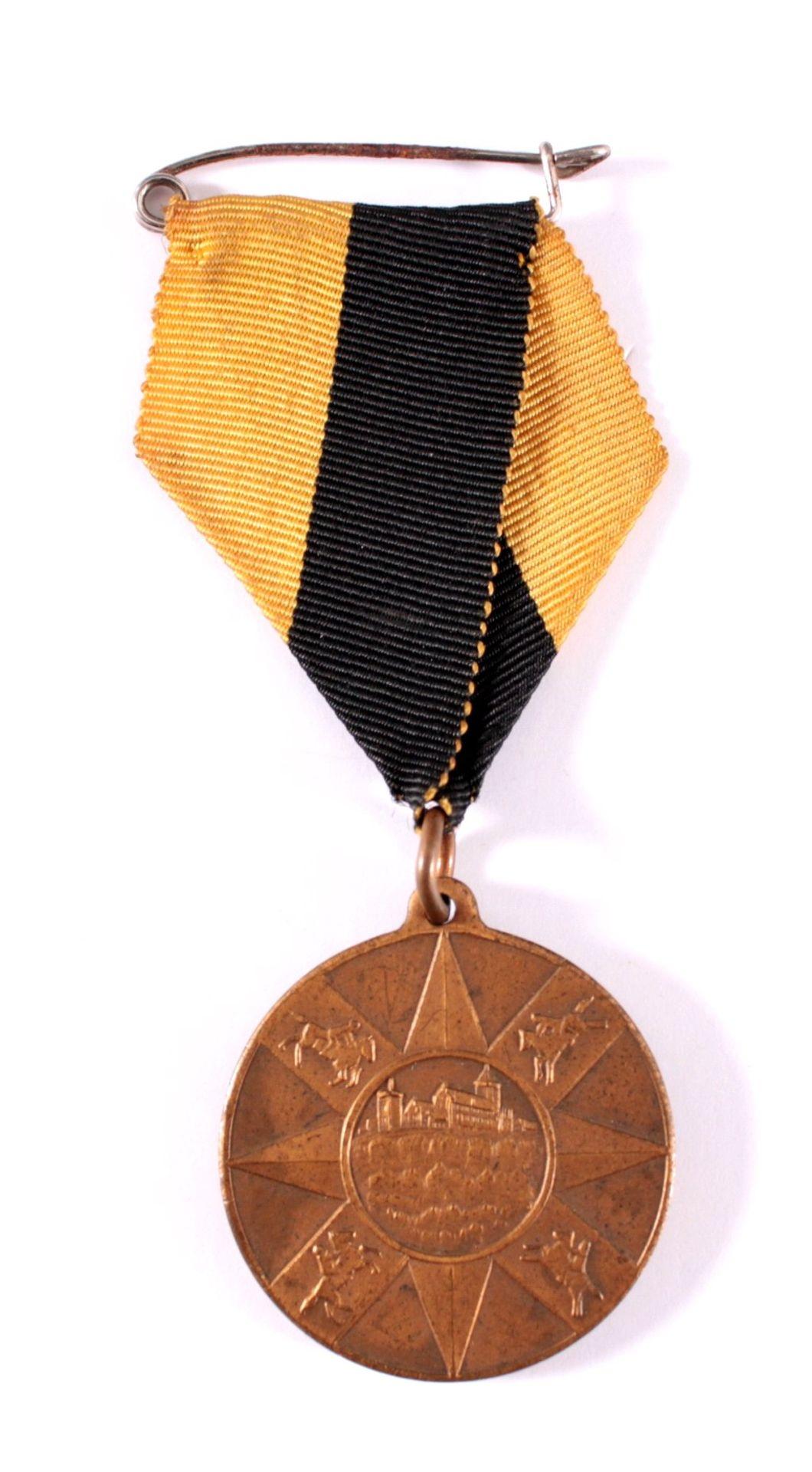 Medaille Stern Staffetten Ritt, Eisenach 1931VS: ohne Text, Motive: Wartburg und 4 Reiter im