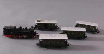 Märklin H0 3312 Dampf-Lok BR 75 042 DB in schwarz mit4 Personenwaggons
