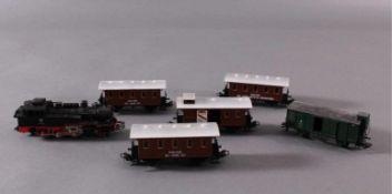 Märklin H0 3095 Dampf-Lok Baureihe 74 701 DB in schwarz mit4 Personenwaggons