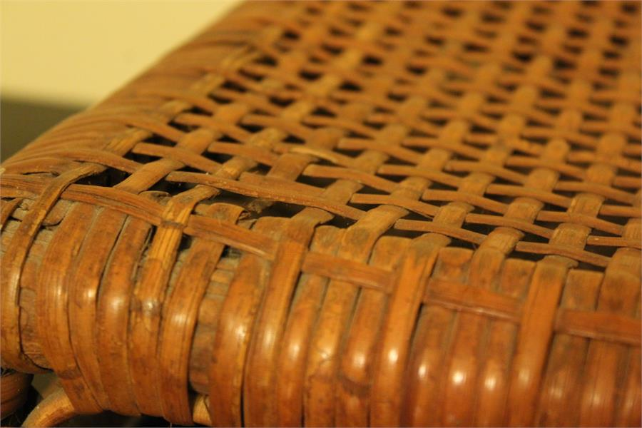 Lot 81 - A Low caned footrest / footstool late 19th century