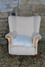 Lot 92 - A deep seated wing armchair early 19th century - legs appear to be cut from a previous height and