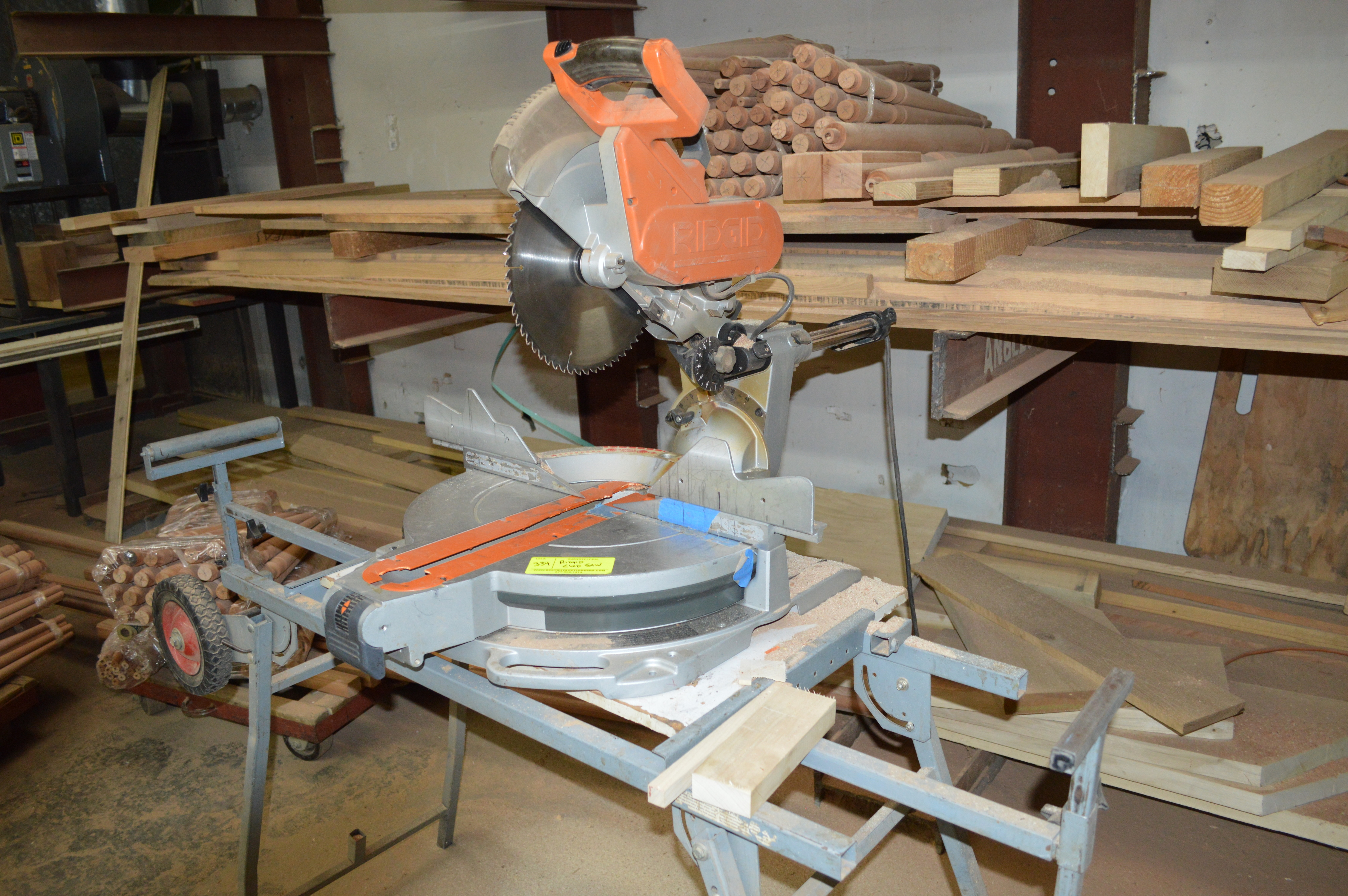Lot 334 - RIDGID 12 INCH LASER GUIDED MITRE TABLE SAW AND STAND