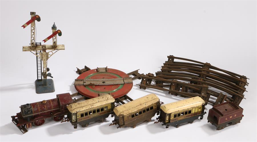 Lot 29 - Hornby series O gauge model railway to include, LMS engine, three carriages, signal, turntable,