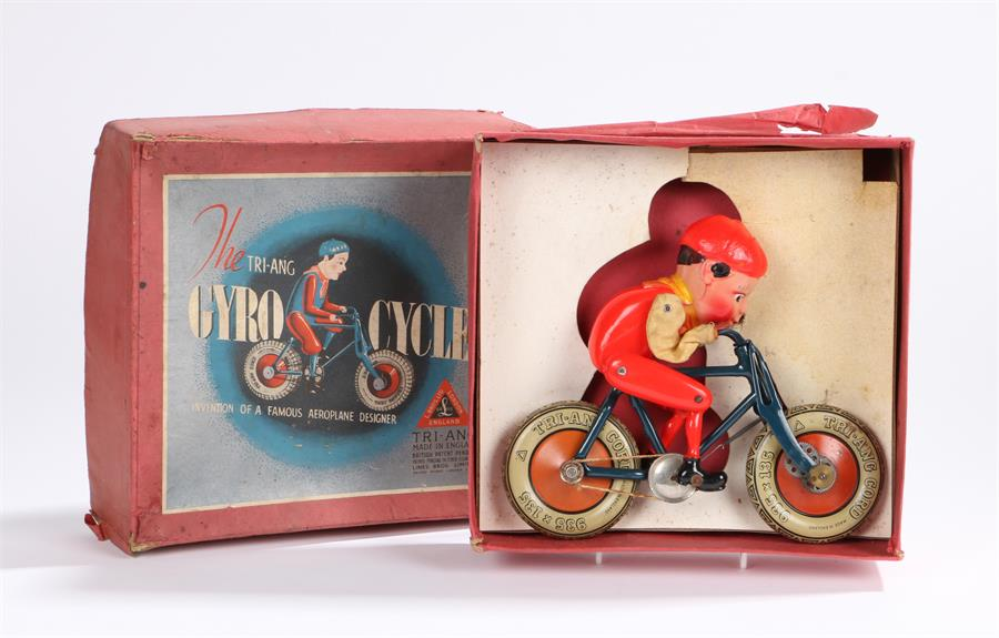 Lot 10 - Triang Gyro Cycle, with blue tinplate frame, Triang cord 935 x 135 wheels, celluloid red plastic