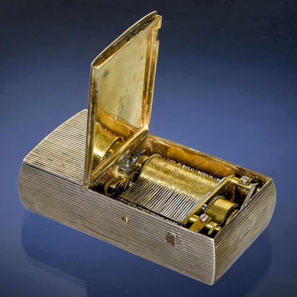 Lot 27 - Rare Prototype Musical Silver Snuff Box, c. 1809-19Playing two airs, with sectional comb in 17 pairs
