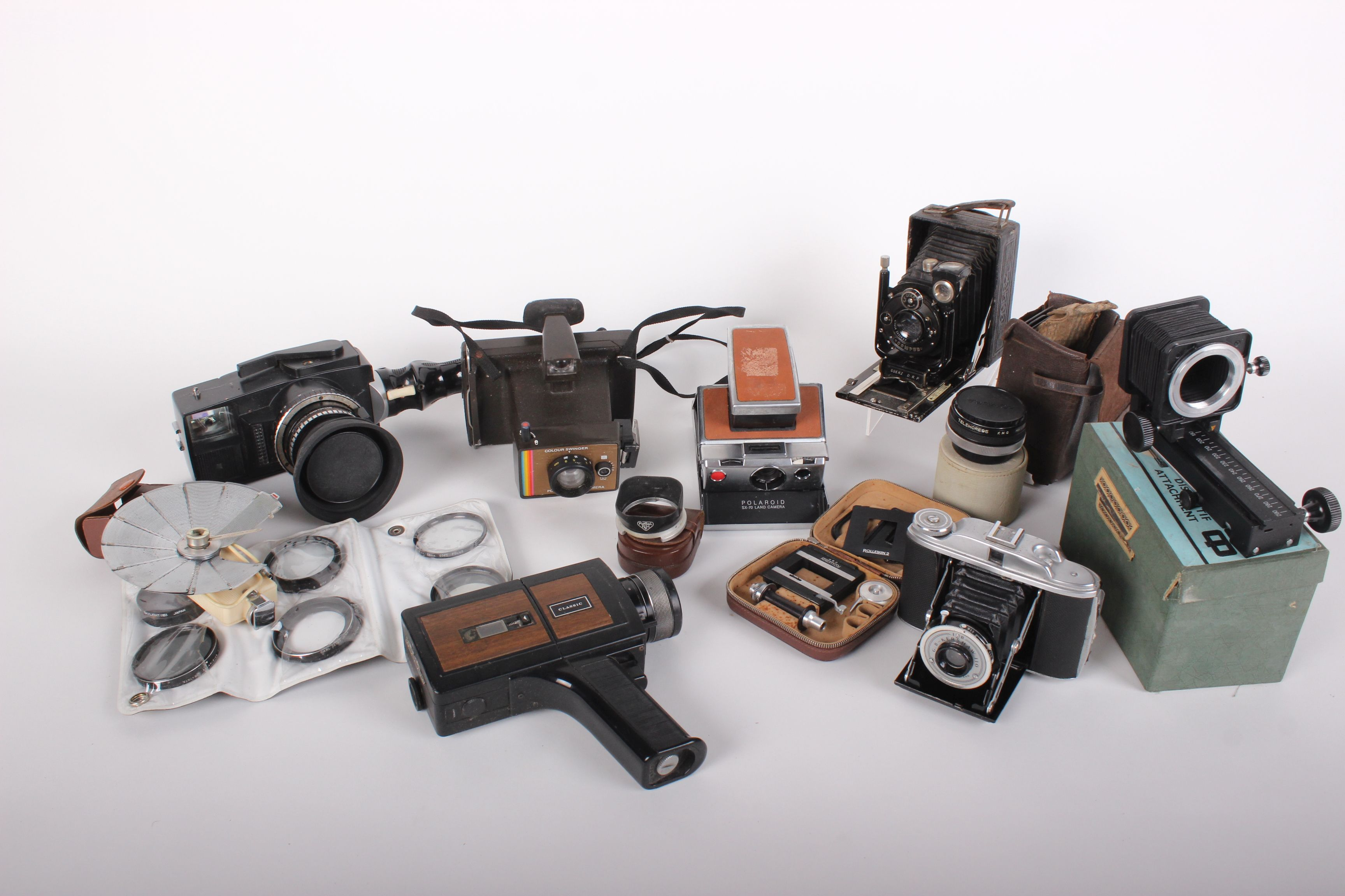 Lot 581 - Cameras: a collection including Pentax Asahi Spotmatic, Kodak Compur in leather case, Brownie
