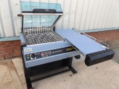 Italdibipack 4225 Heated impulse L sealer blade. Adjustable packing table to accommodate different