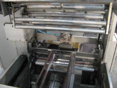 BFB MS500 compact design stretch banding machine. Maximum output 30 bundles per minute. Carton