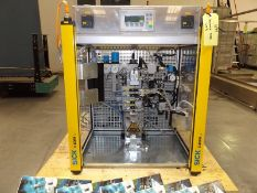 Komax Sosei test unit for assembly of non-pressurised, metered dose drug delivery containers with
