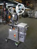 Arca Etichette Wind Top label applicator with Argus Laetus coder, L150/250 performance, air reject