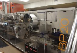 IWKA model BP20i blister packing machine. Track set up 285mm wide with 4 lines per track. Film width