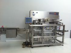 Interpac Waldner TS6030 tray sealer for single cavity PET trays. Currently set for trays of the