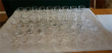 A collection of 45 assorted drinking glasses, crystal and cut glass.