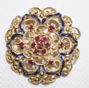 An unmarked gold Victorian pierced decorated round